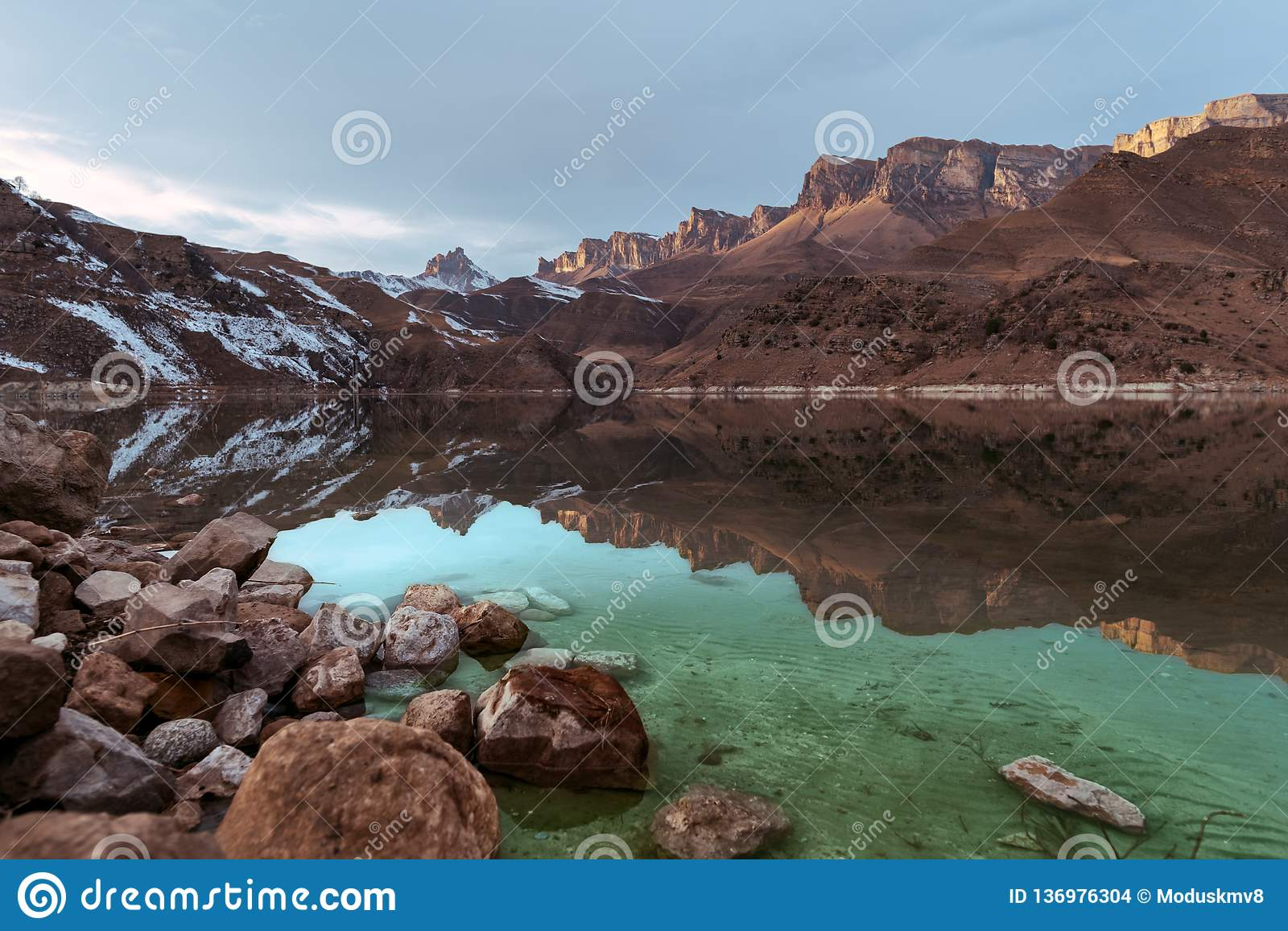 Beautiful sunset in the reflection of a mountain lake