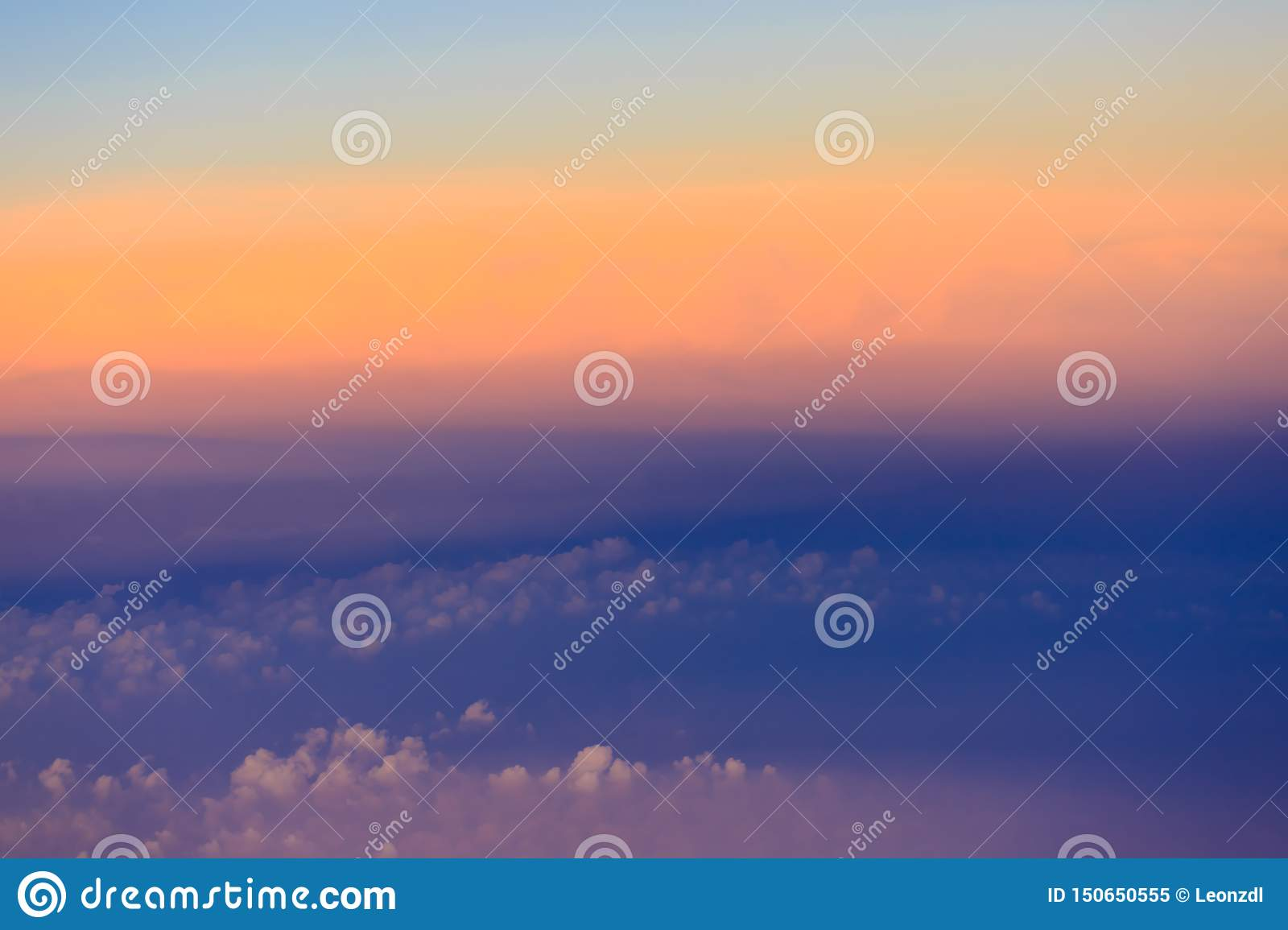 Beautiful sunset sky above clouds with dramatic light