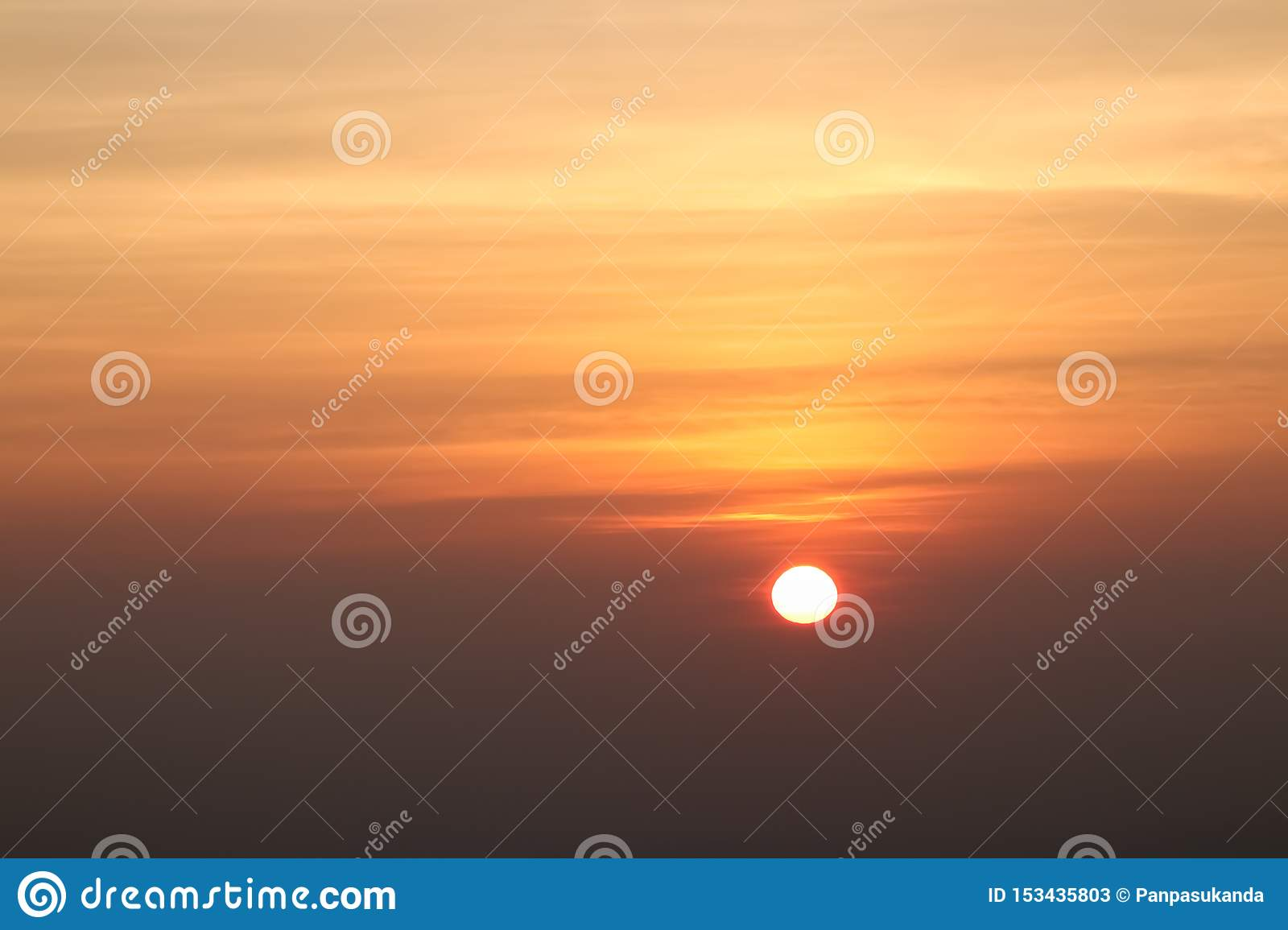 Beautiful sunset or sunrise sky above clouds with dramatic light