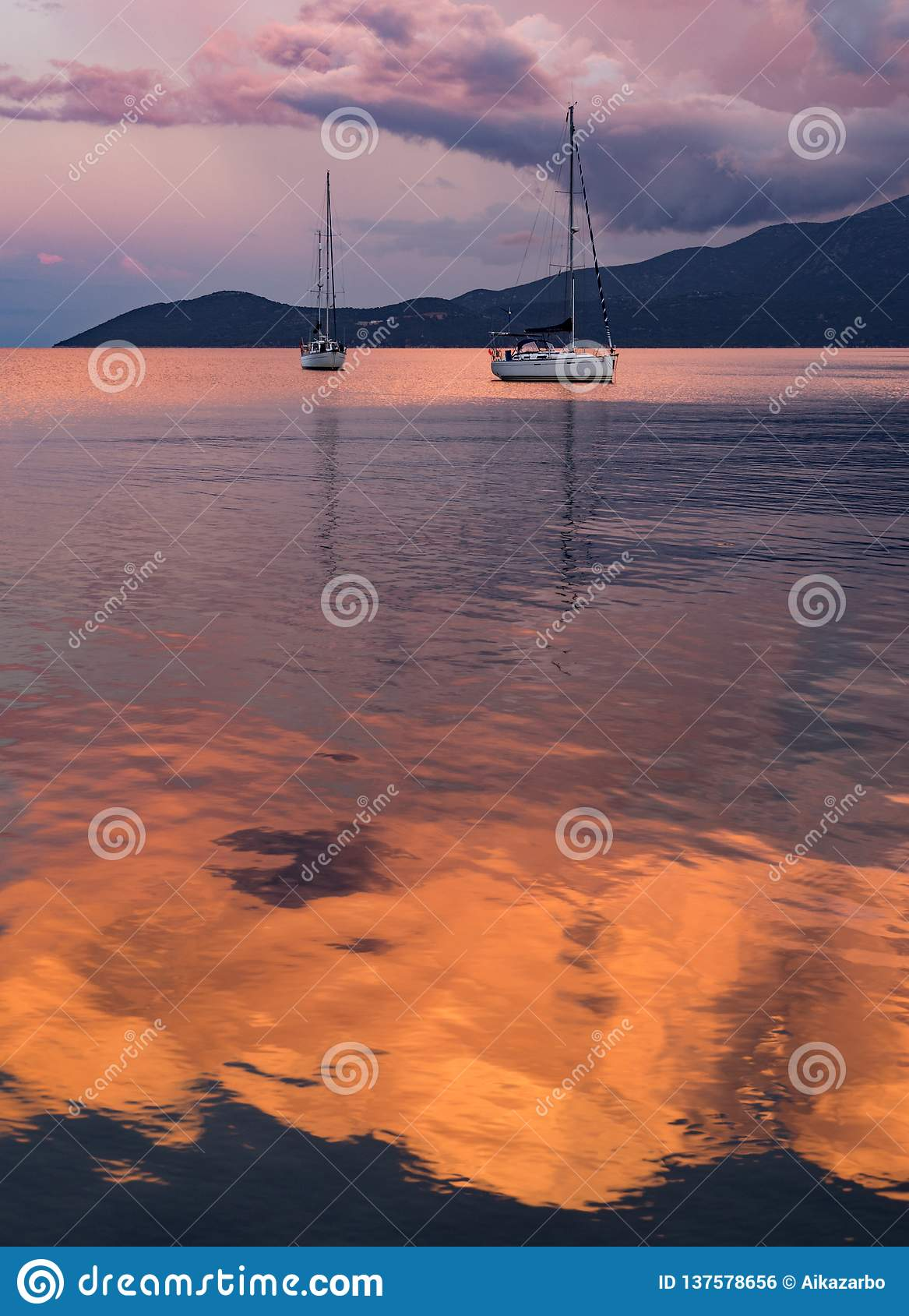 Beautiful sunset and yacht in the Ionian Sea on the island of Kefalonia in Greece