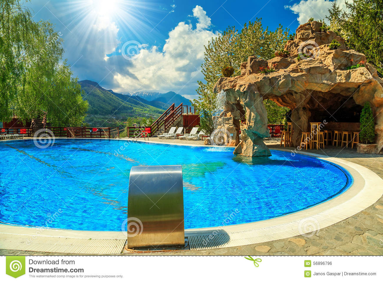 Beautiful swimming pool with beach bar and waterfall stock Swimming pool beautiful