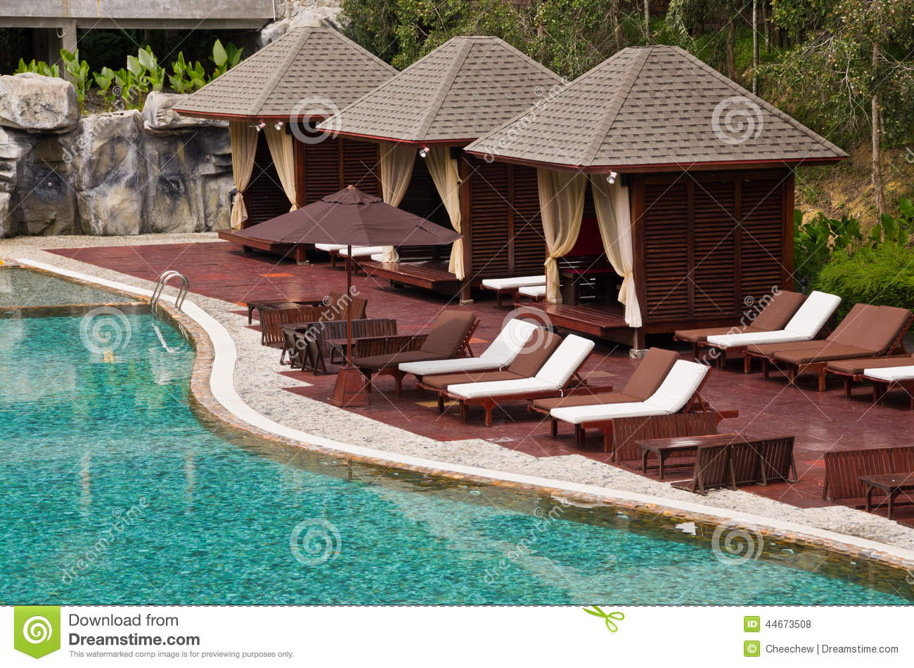 Beautiful Swimming Pool Chair And Hut In Tropical Resort