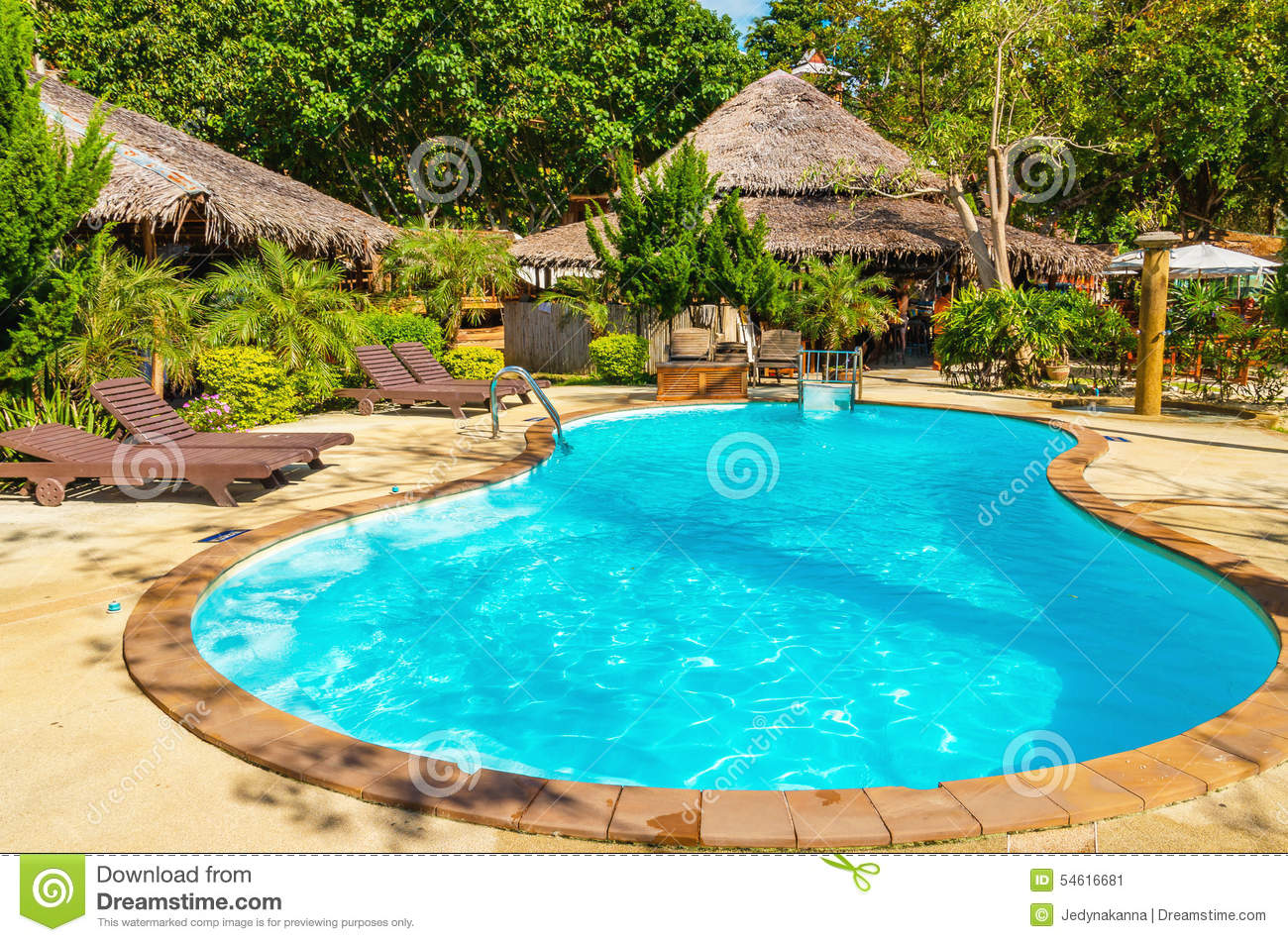 Beautiful swimming pool close to exotic beach stock photo Swimming pool beautiful