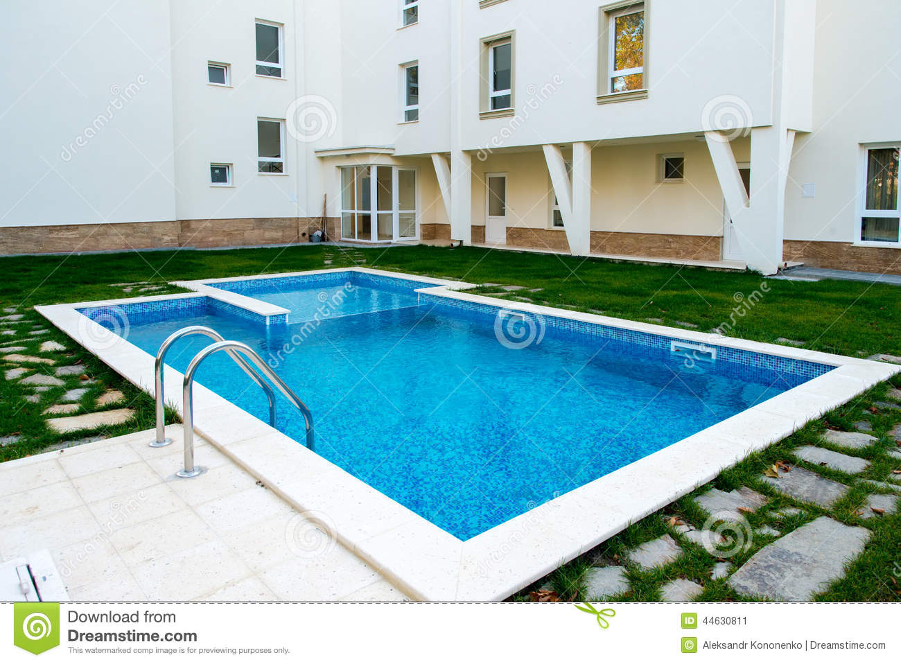 Beautiful swimming pool filled with water in a residential Swimming pool beautiful