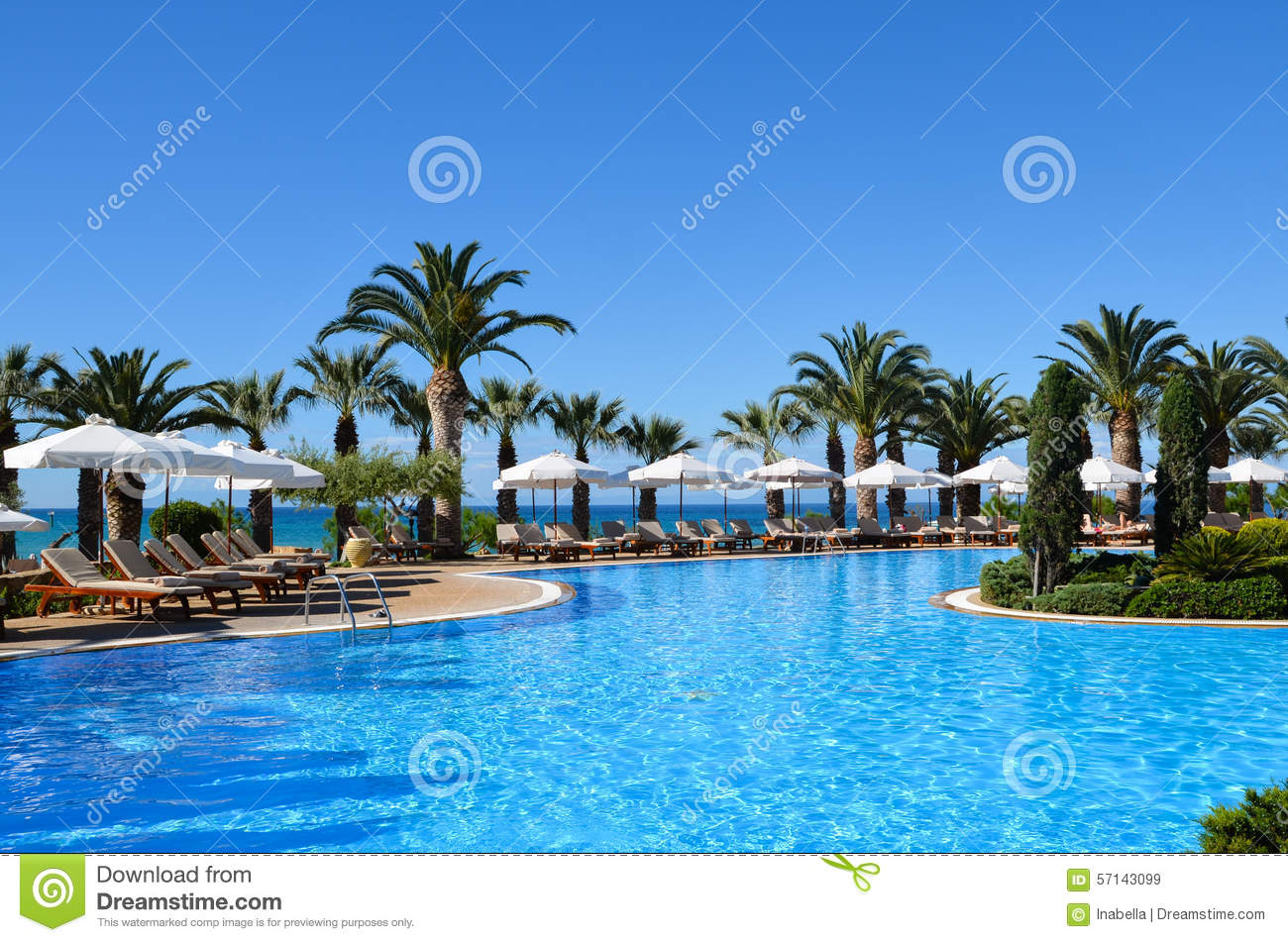 Beautiful swimming pool of a luxury hotel with sun baths Swimming pool beautiful