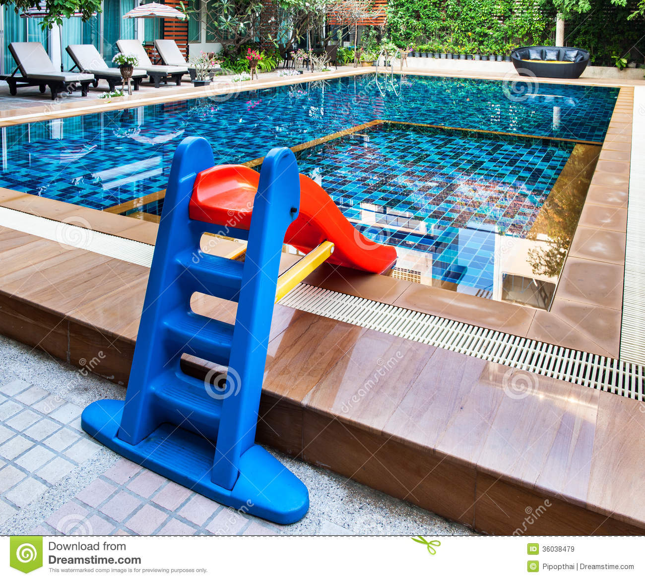 Beautiful swimming pool with tot slide stock image for Swimming pool slides
