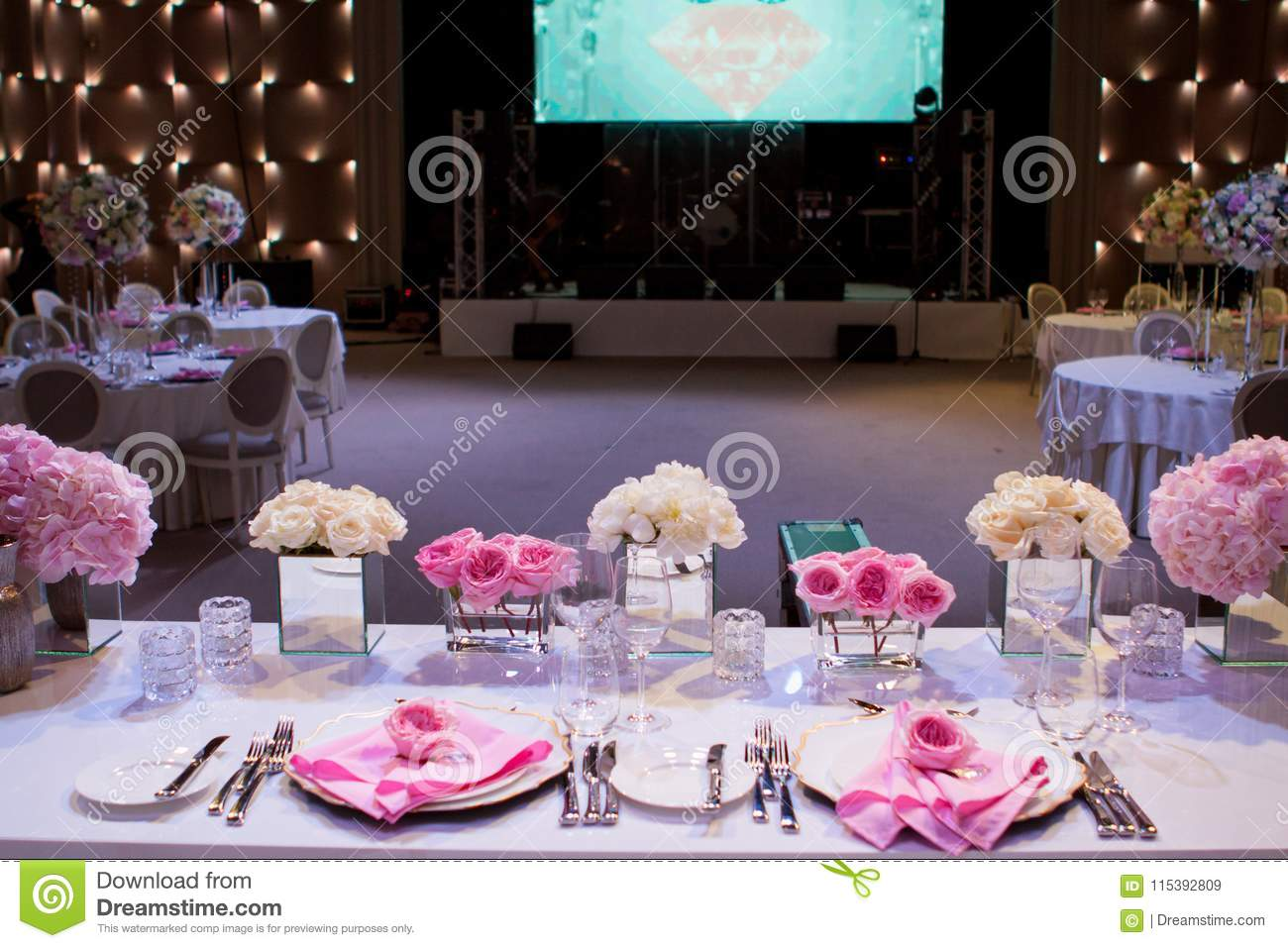 Beautiful Table Setting With A White Tablecloth And Pink