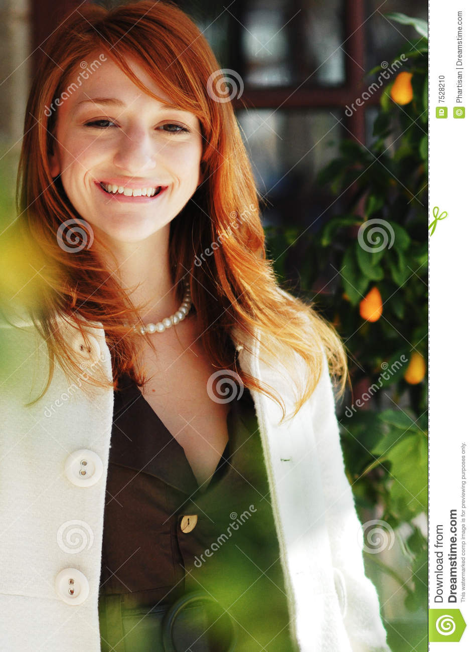 tall red headed woman wearing designer fall fashion clothing
