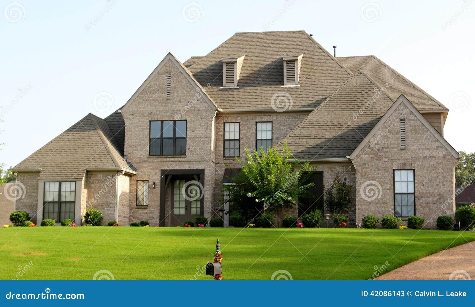 Beautiful Tan Brick And Stucco Suburban Home Stock Photo