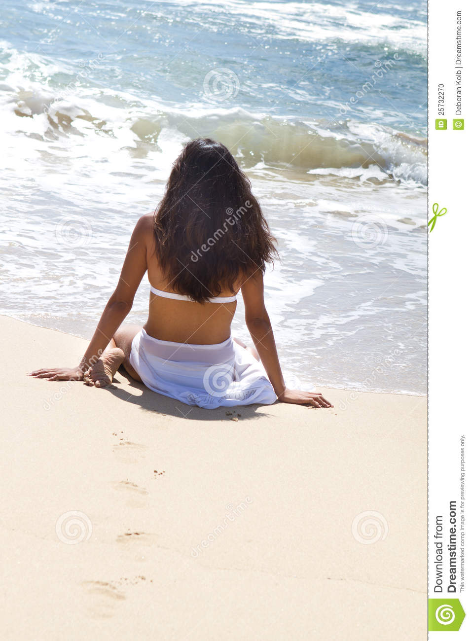 Beautiful tanned Woman Relaxing in Paradise