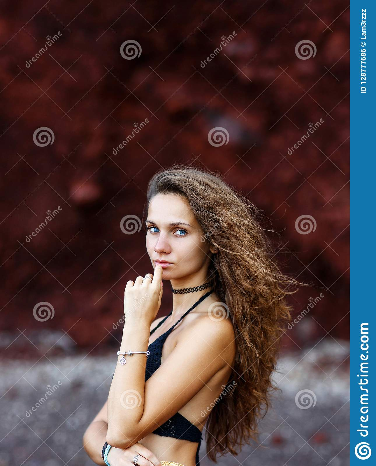 Portrait of Sexy Brunette on Red Background Stock Photos