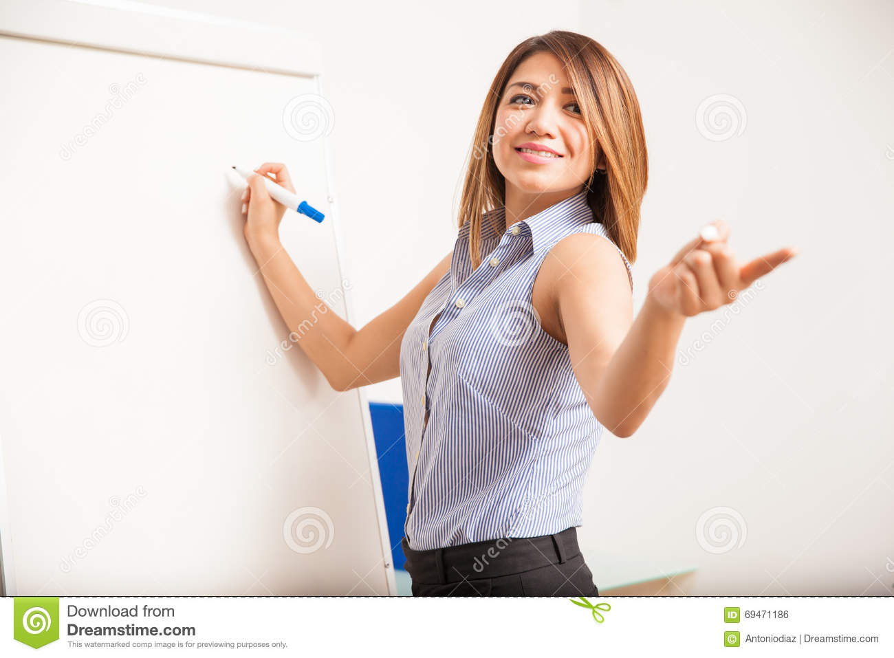 Beautiful Teacher Asking A Question Stock Photo - Image: 69471186