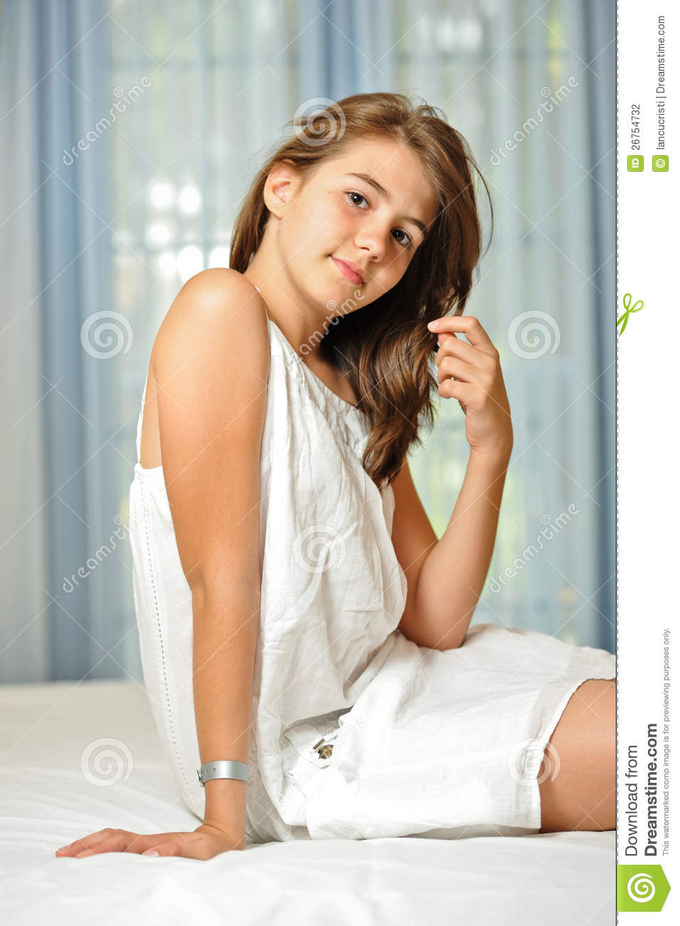 Beautiful teen girl at home in white dress stock photo for Teen home pic
