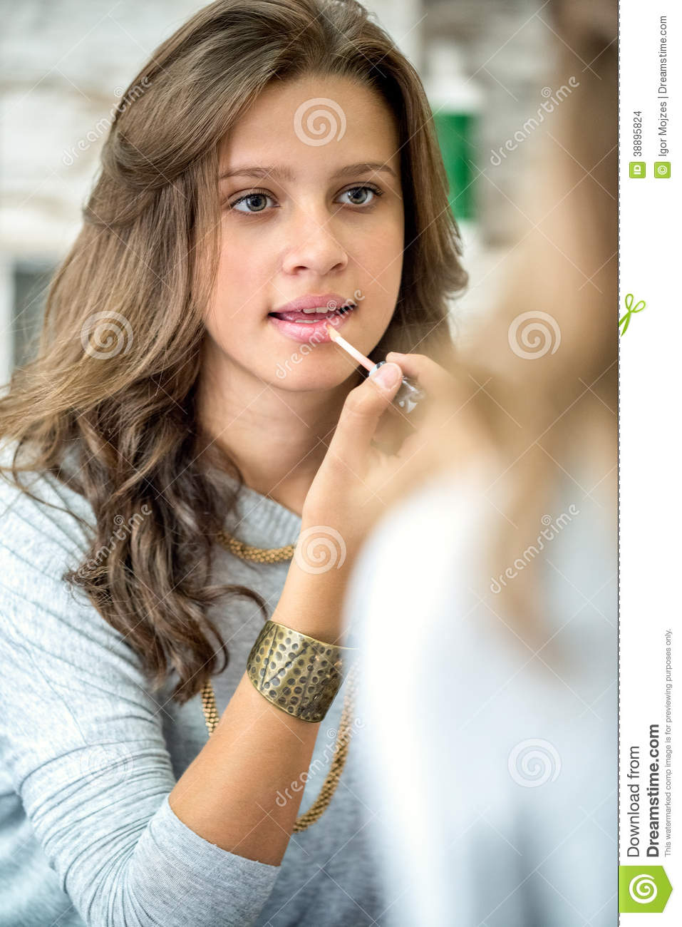 Beautiful Teen Girl With Lip Gloss Stock Photo