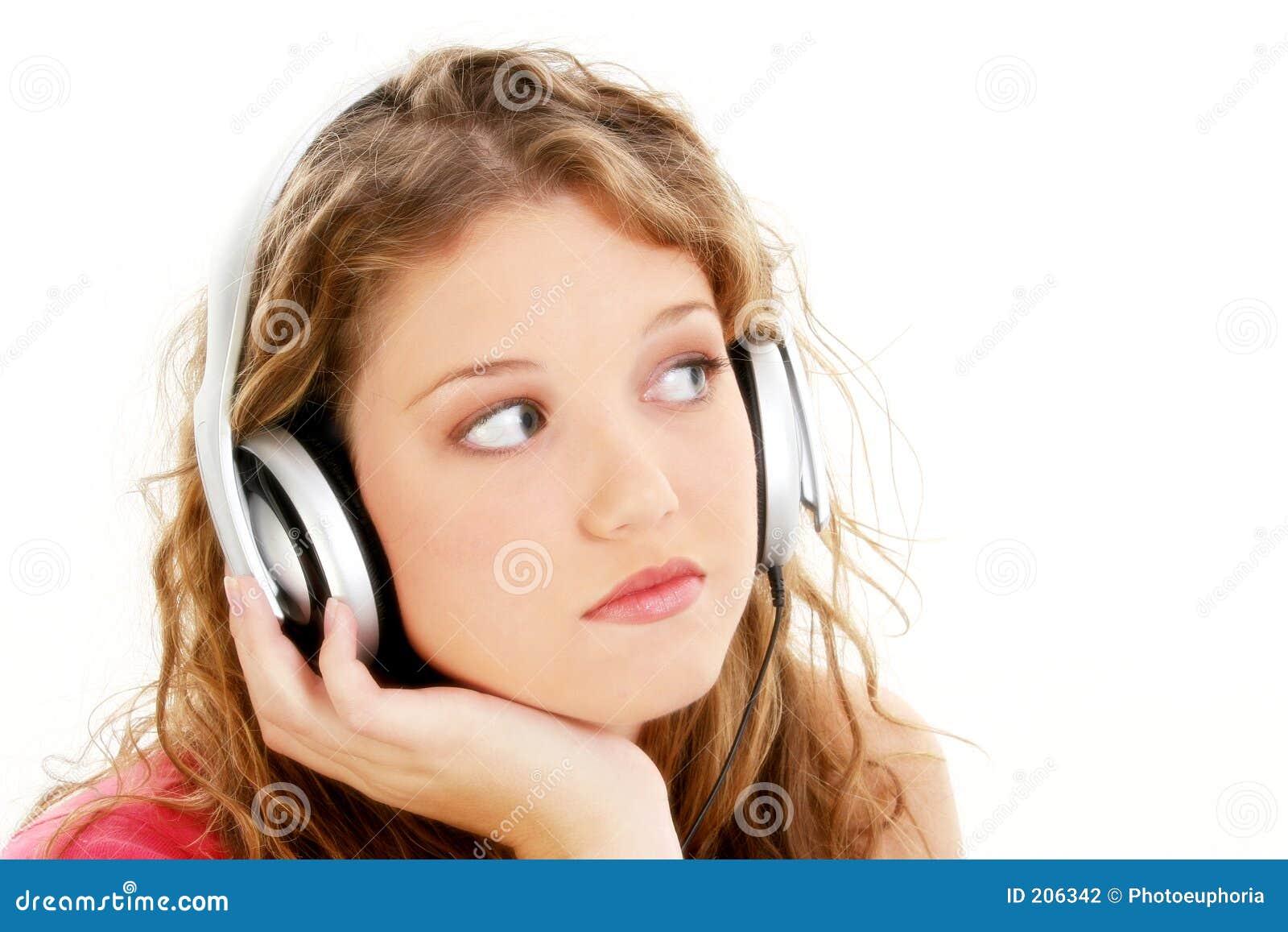 Beautiful teen girl listening to headphones stock for Teenage beautiful girls