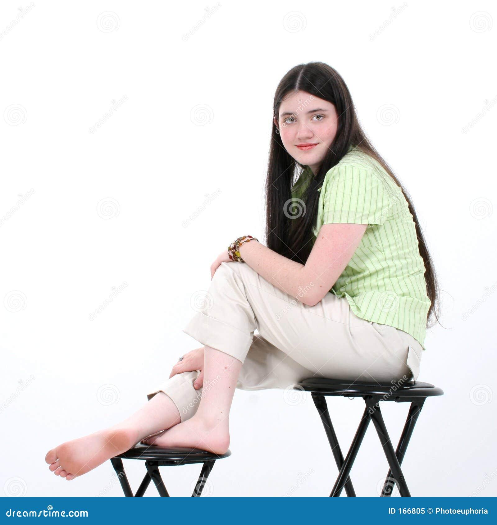 Beautiful Teen Girl Sitting On Stool
