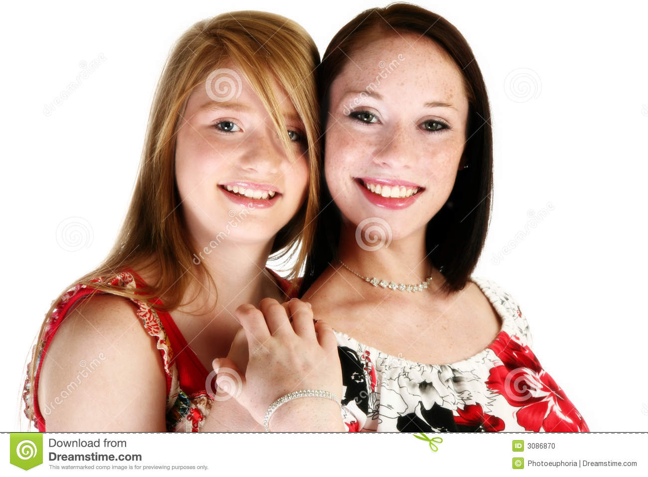 Beautiful 17 year old and 15 year old teen sisters over white.