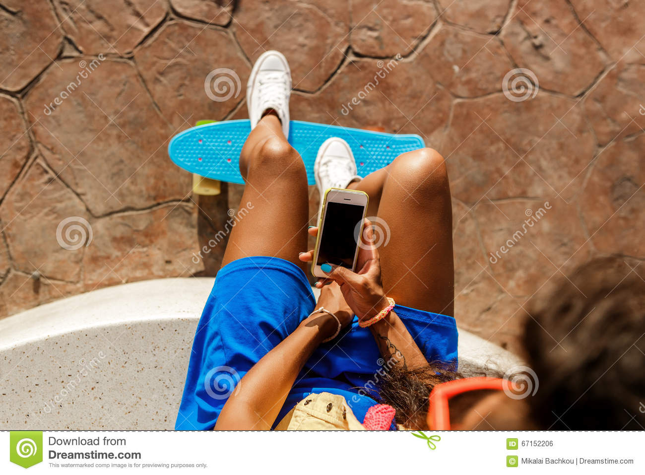 3cd3d21c334c9 Beautiful Teenage Black Girl In Blue Skirt Sit With Her Smartphone ...