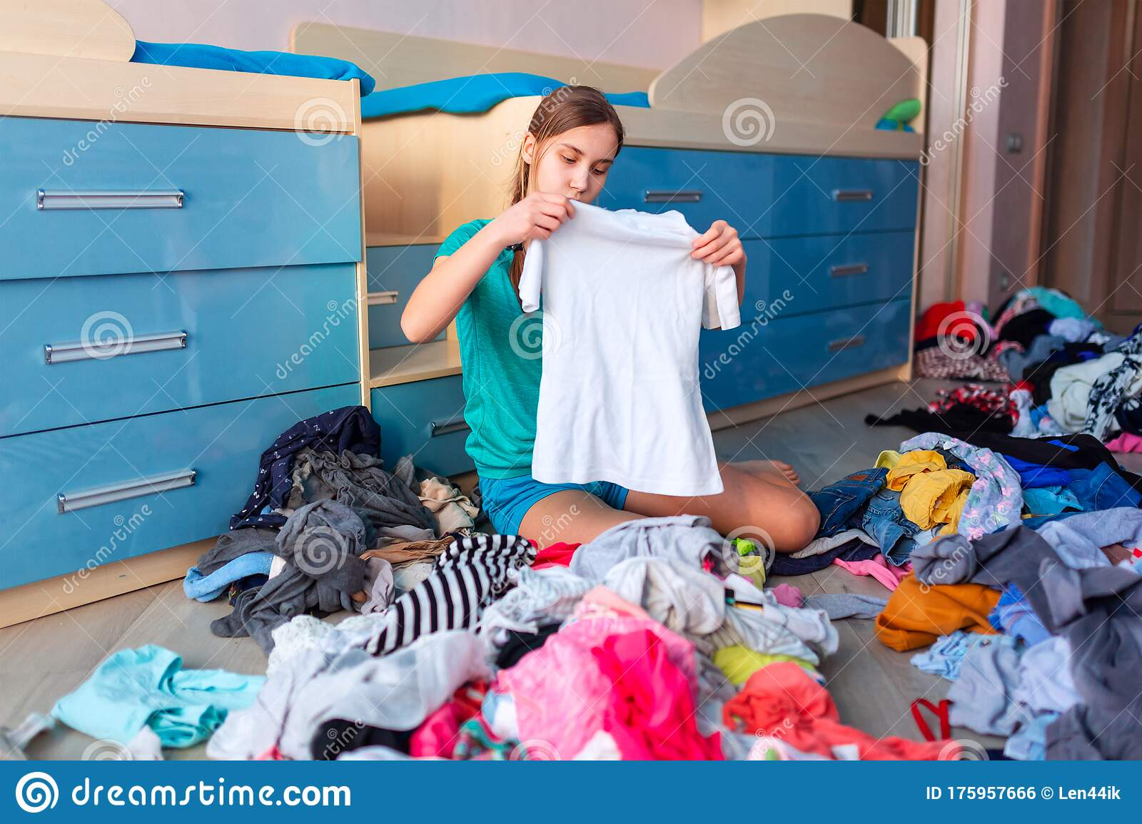 Beautiful Teenage Girl Folding Her Messy Clothes In A Her Bedroom Stock Photo Image Of Disorganized Mess 175957666