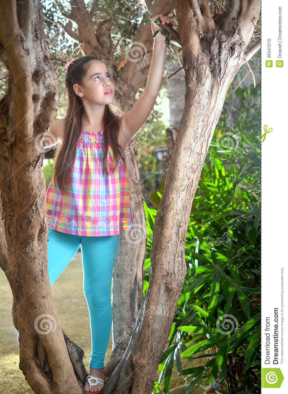Beautiful Teenage Girl In An Olive Tree Stock Image -7748