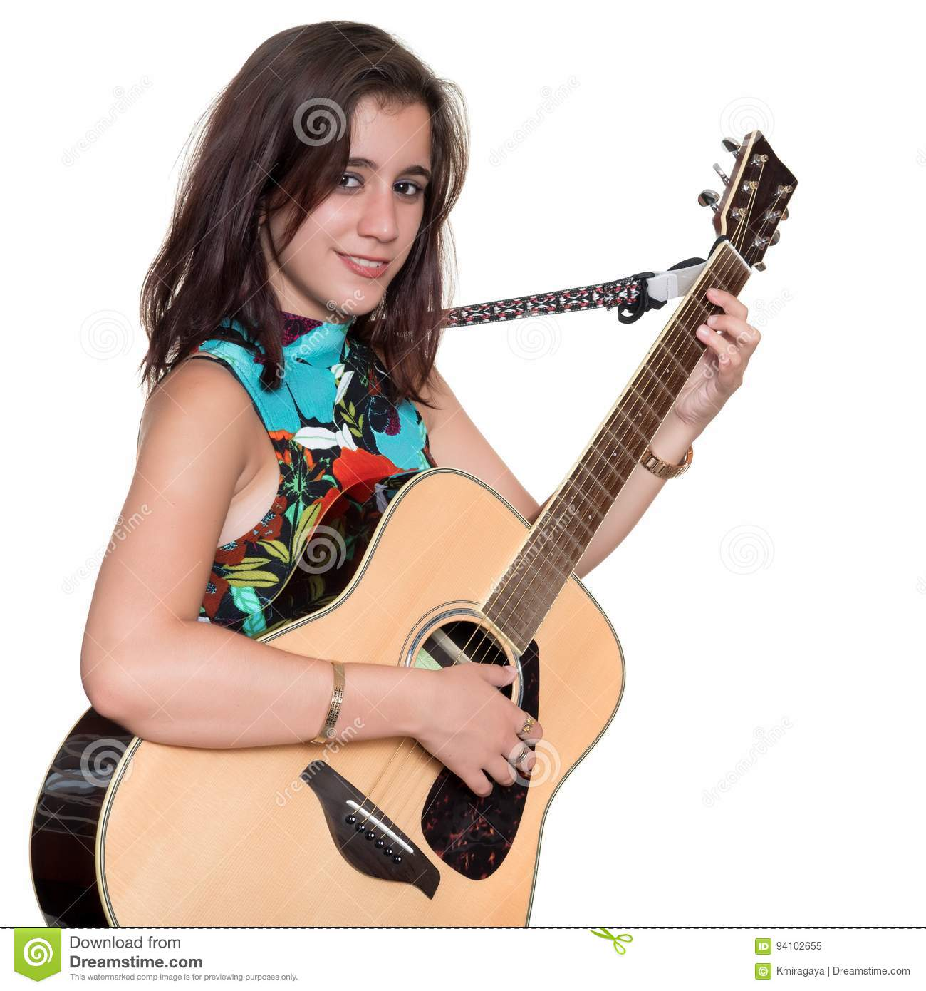 Beautiful teenage girl playing an acoustic guita isolated on white