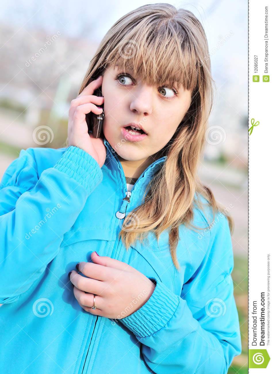 Beautiful teenager girl talking by cellular phone