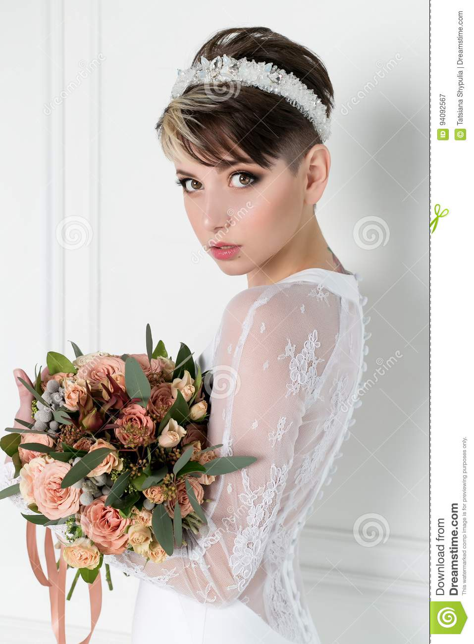 Beautiful Tender Bride Girl With Short Haircut With Crown On Head