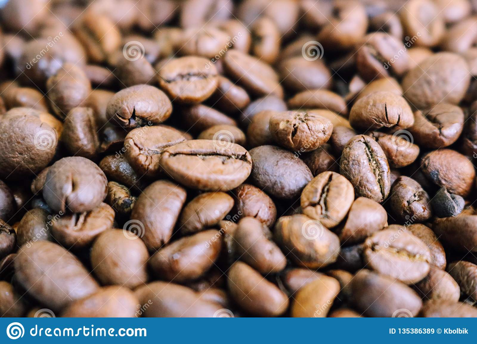 Beautiful texture of freshly roasted selected delicious rich brown natural fragrant coffee tree grains, Arabica coffee beans