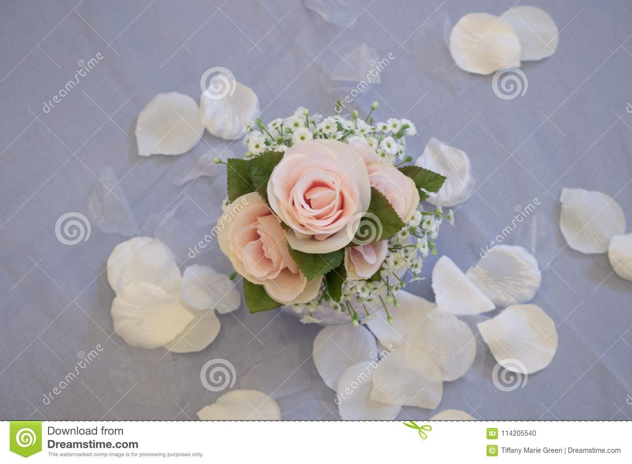 The Beautiful Three Rose Centerpiece At A Wedding Stock Photo
