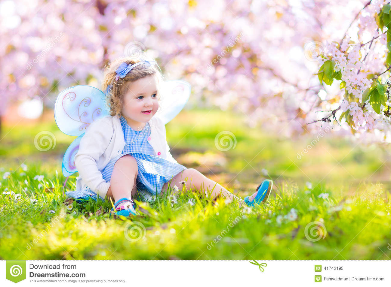 26b590e1db4 Beautiful Toddler Girl In Fairy Costume In Fruit Garden Stock Image ...