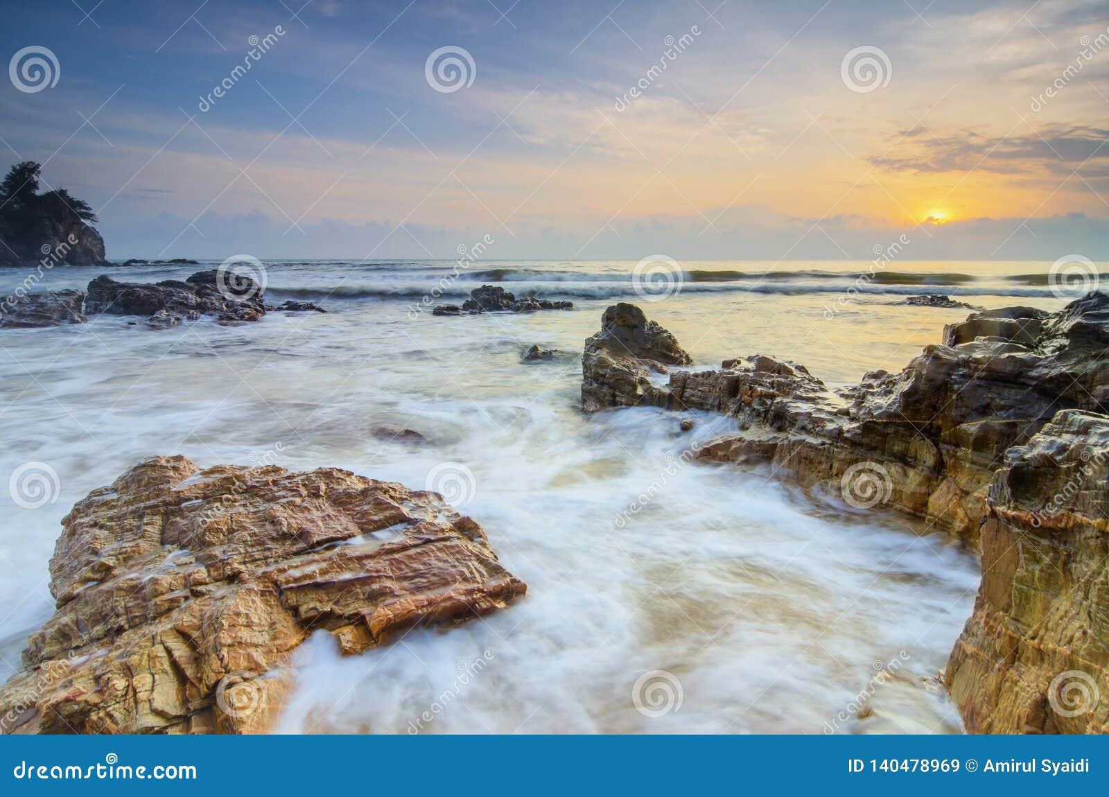 beautiful tropical beach sunrise sea view. soft wave hitting sandy beach