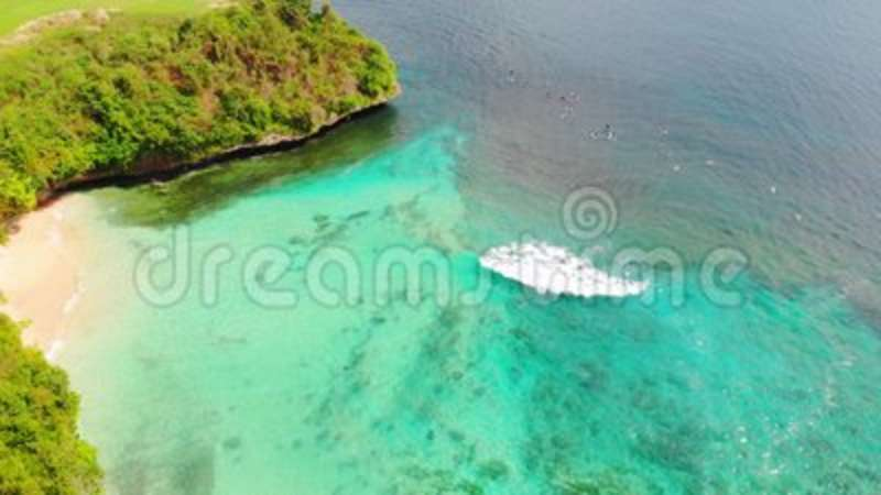 Beautiful tropical beach and turquoise ocean water with waves, aerial video