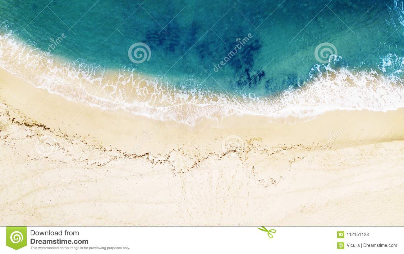 Beautiful tropical empty beach and sea waves. Aerial view.