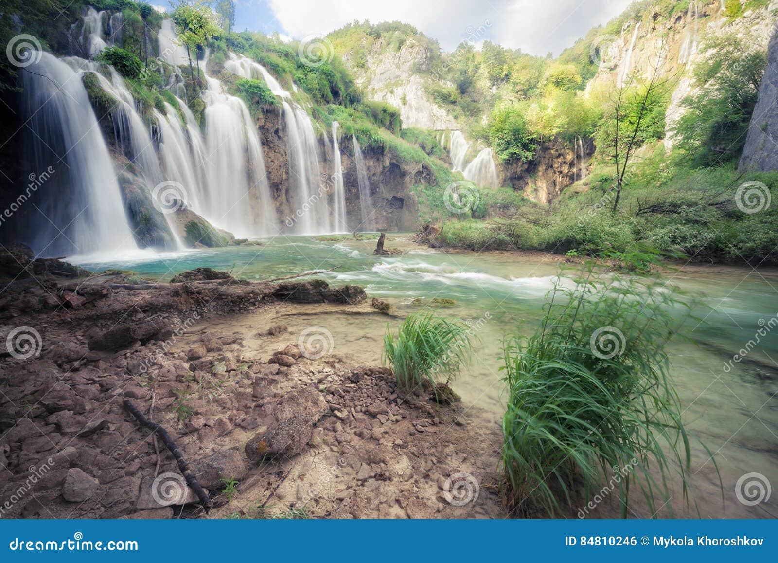 Download Beautiful Tropical Waterfall Stock Photo - Image of background, footbridge: 84810246