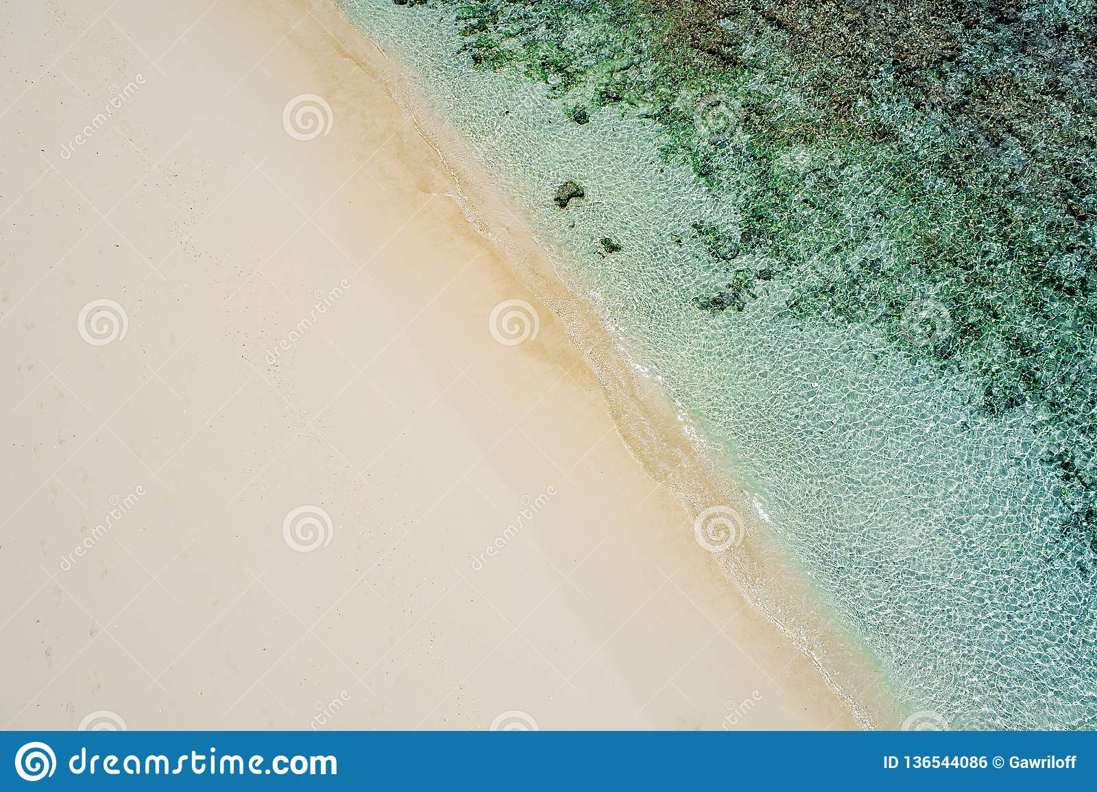 Beautiful tropical white empty beach and sea waves seen from above. Seychelles beach aerial view