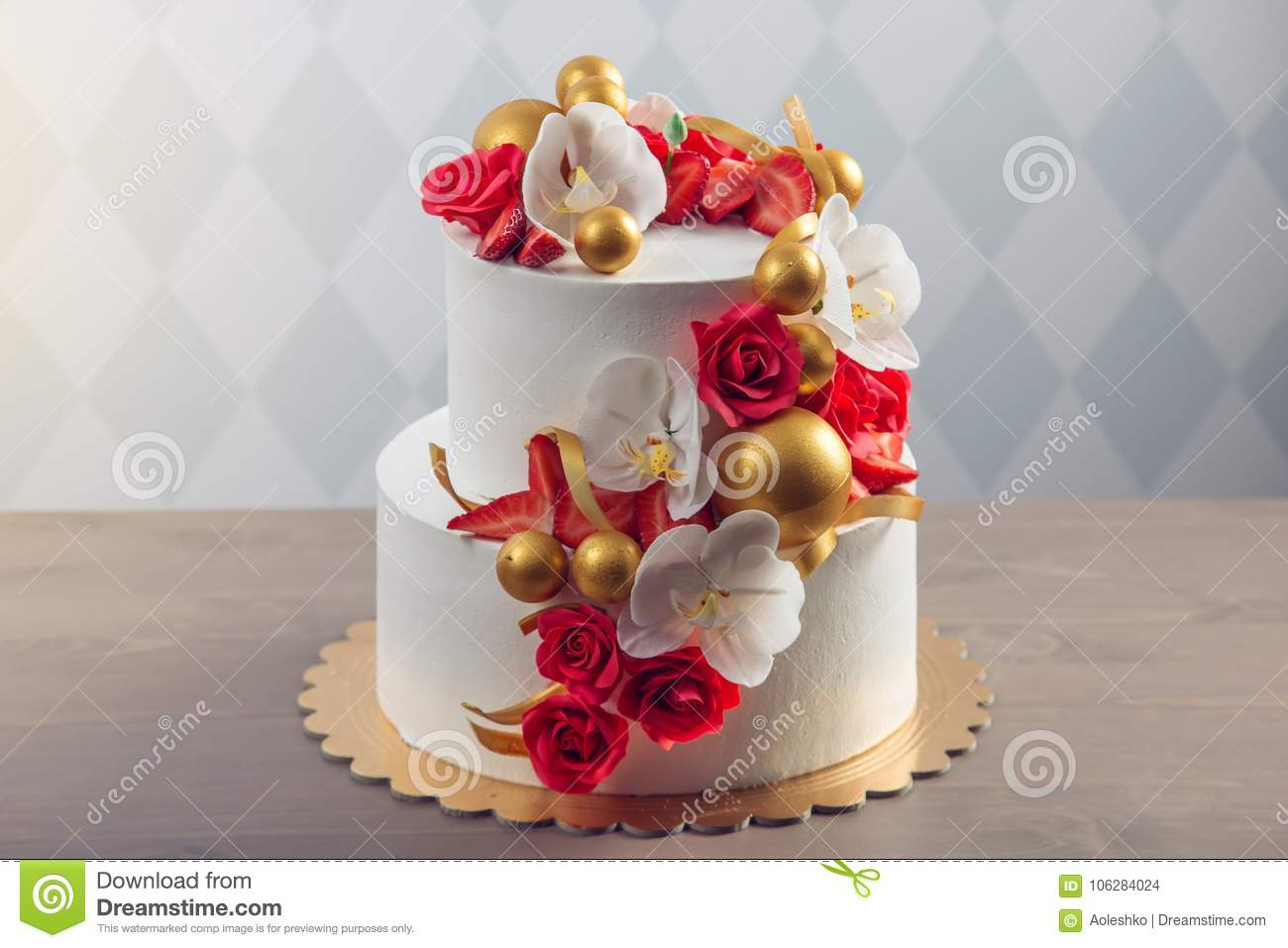 Beautiful Two Tiered White Wedding Cake Decorated With Red Roses