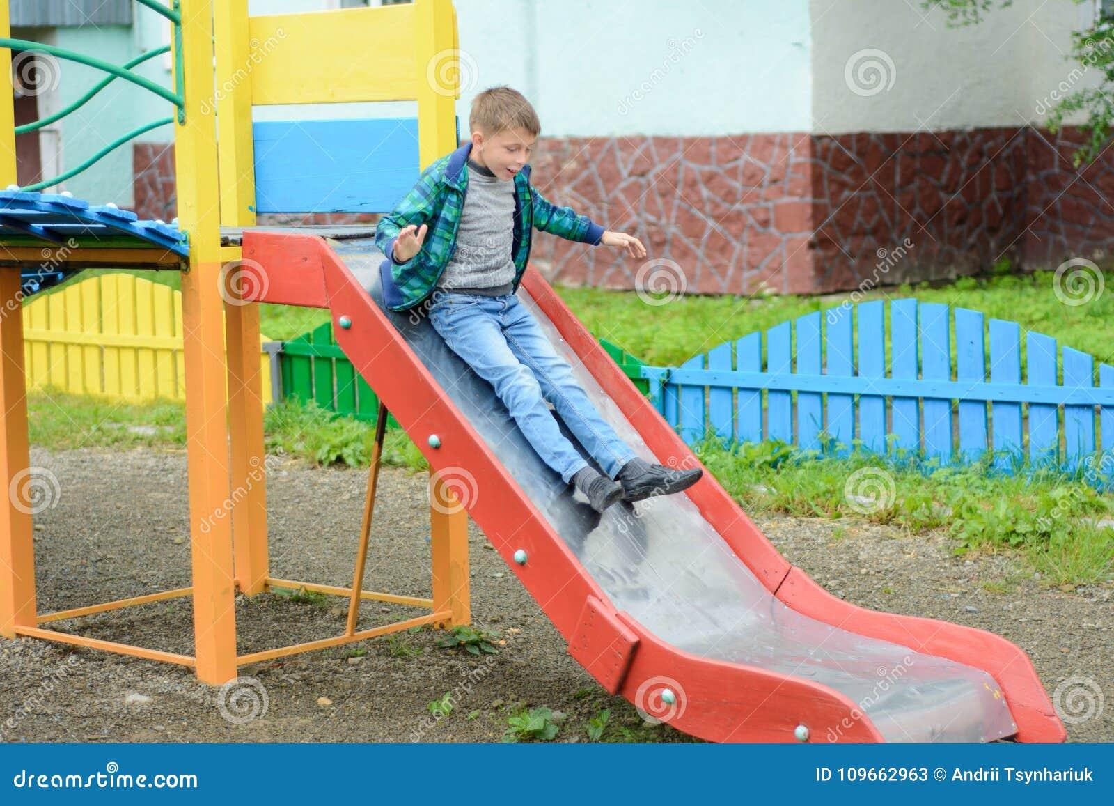 Funny children play on a children`s playground