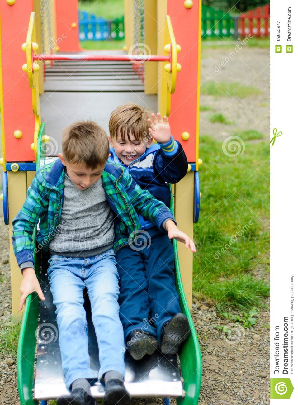 Funny children play on a children`s playground
