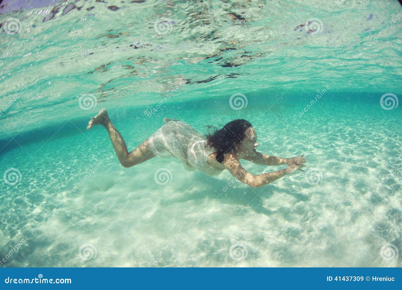 Stock photo beautiful underwater bride in maldives woman diving sea