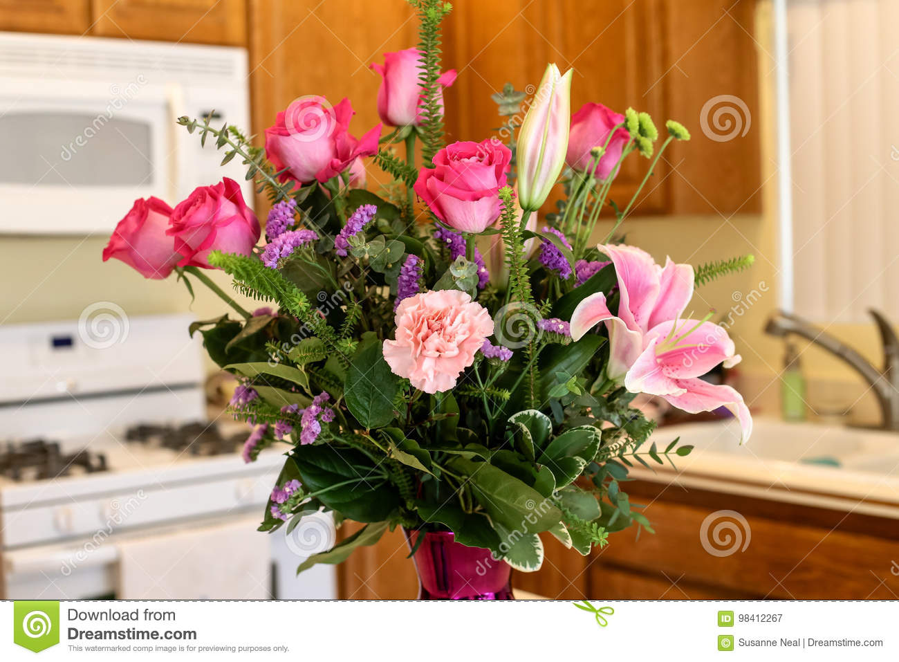 Beautiful Vase Of Pink Flowers Including Roses Carnations And