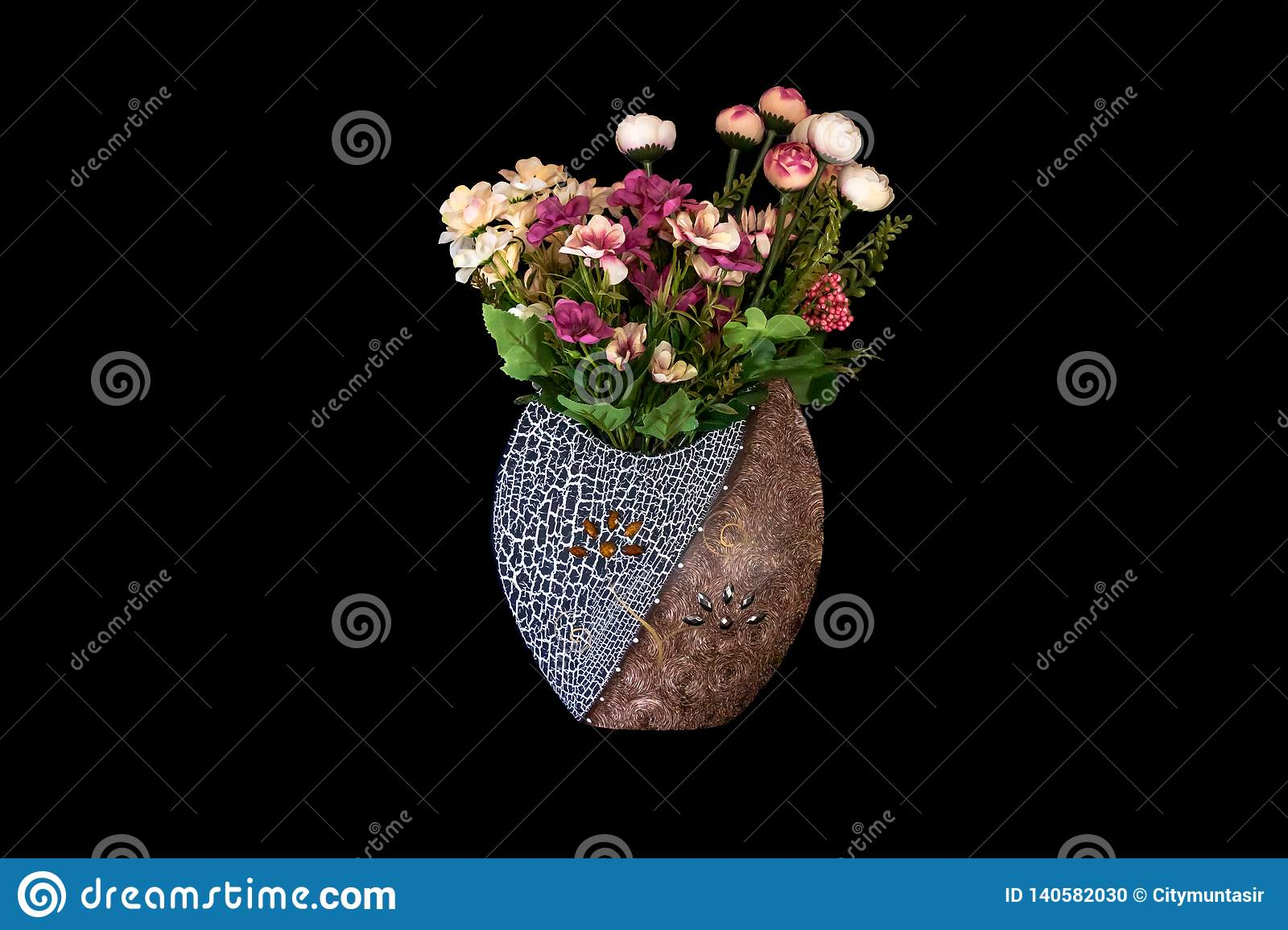 Beautiful Vase with yellow, red, pink, purple plastic flowers and leaves in Solid Black Background