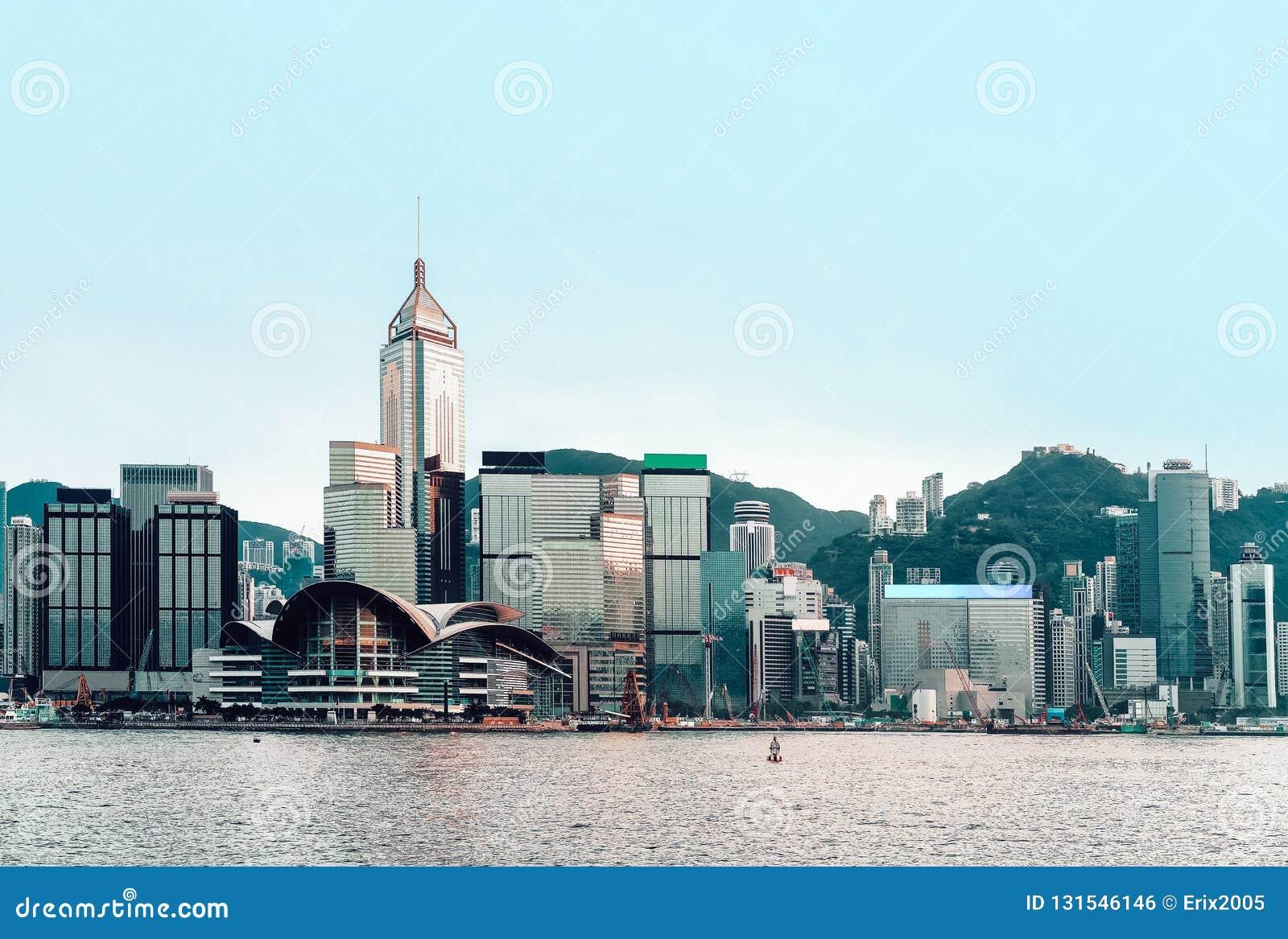 Beautiful Victoria Harbor of Hong Kong at sundown. View from Kowloon on HK Island royalty free stock image