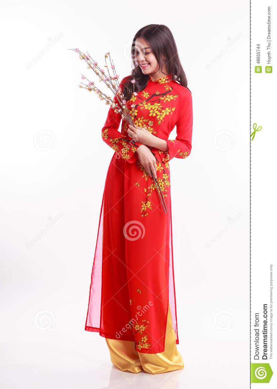 Beautiful Vietnamese Woman With Red Ao Dai Holding Cherry