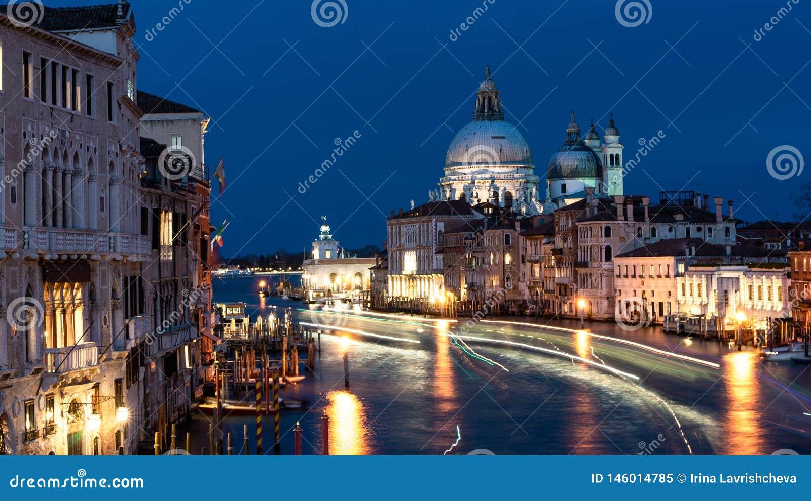 Beautiful view on Basilica di Santa Maria della Salute in golden evening light at sunset in Venice, Italy