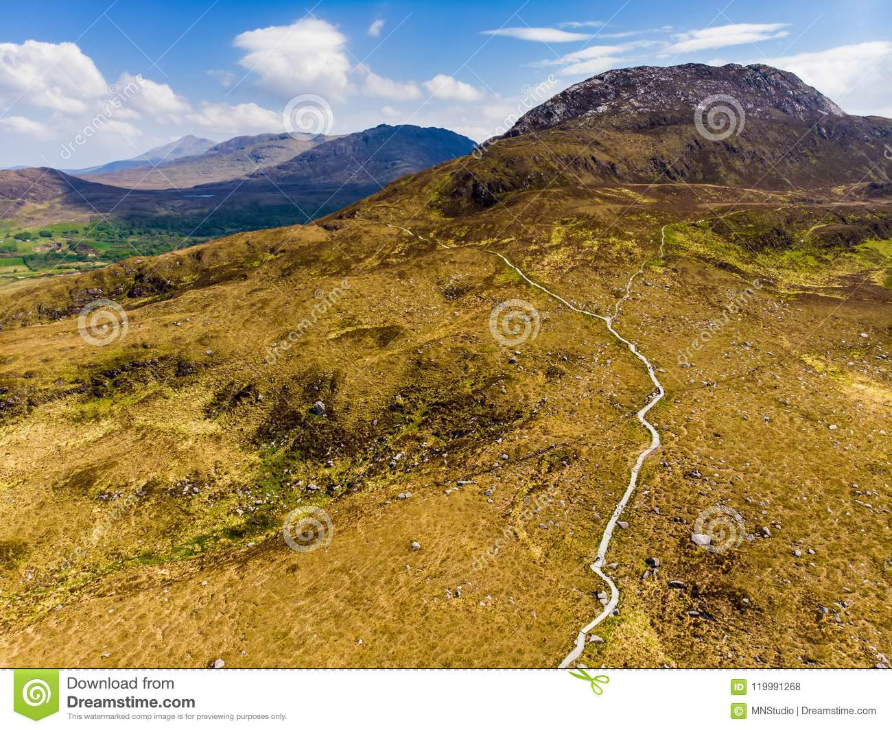Beautiful view of Connemara National Park, famous for bogs and heaths, watched over by its cone-shaped mountain, Diamond Hill, Ire