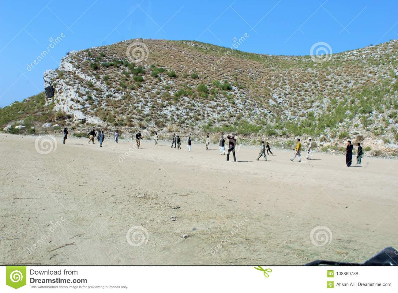 Boys playing football in the valley
