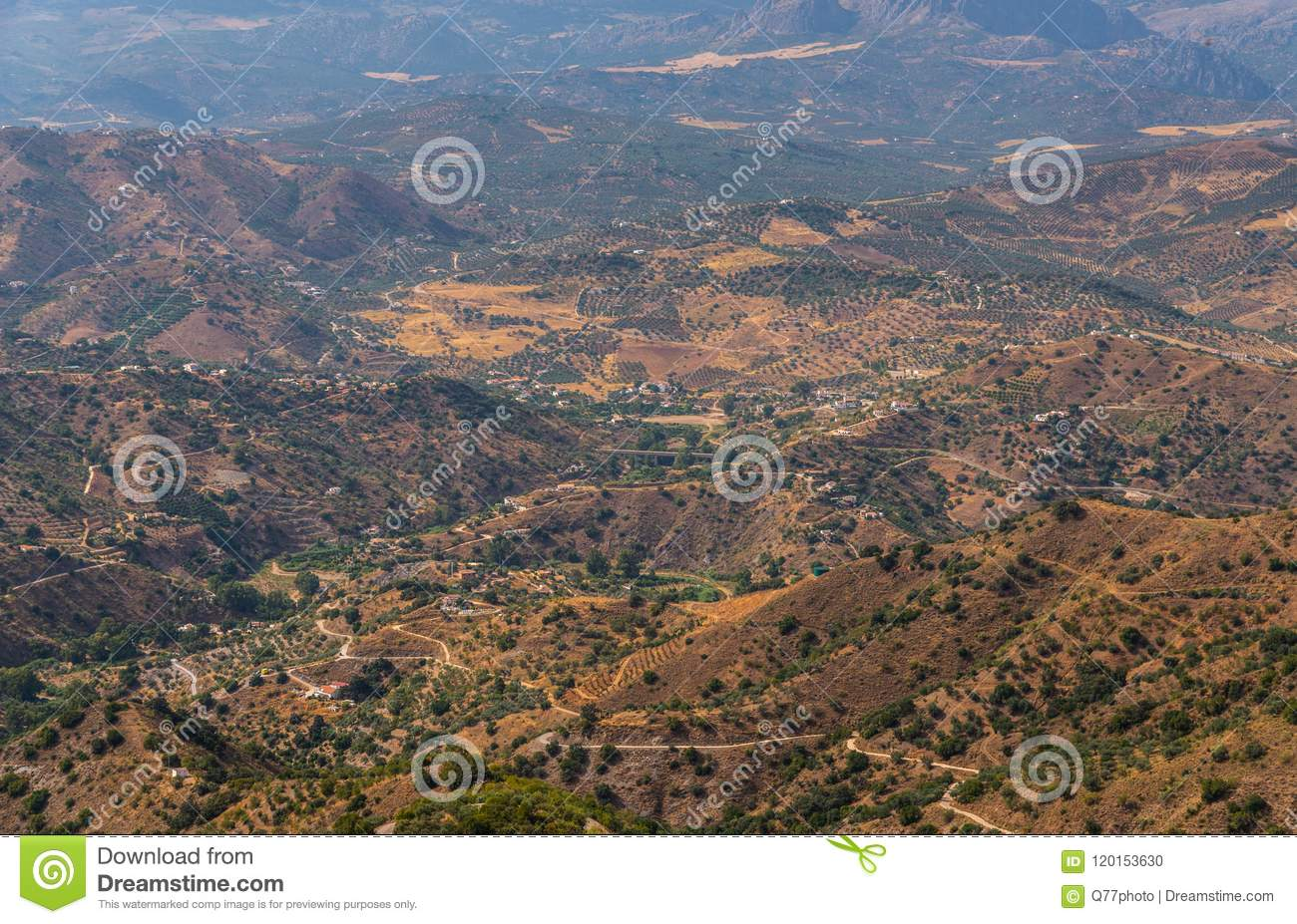 beautiful view of the mountains in the region of Andalusia, houses and farmland on the slopes of mountains