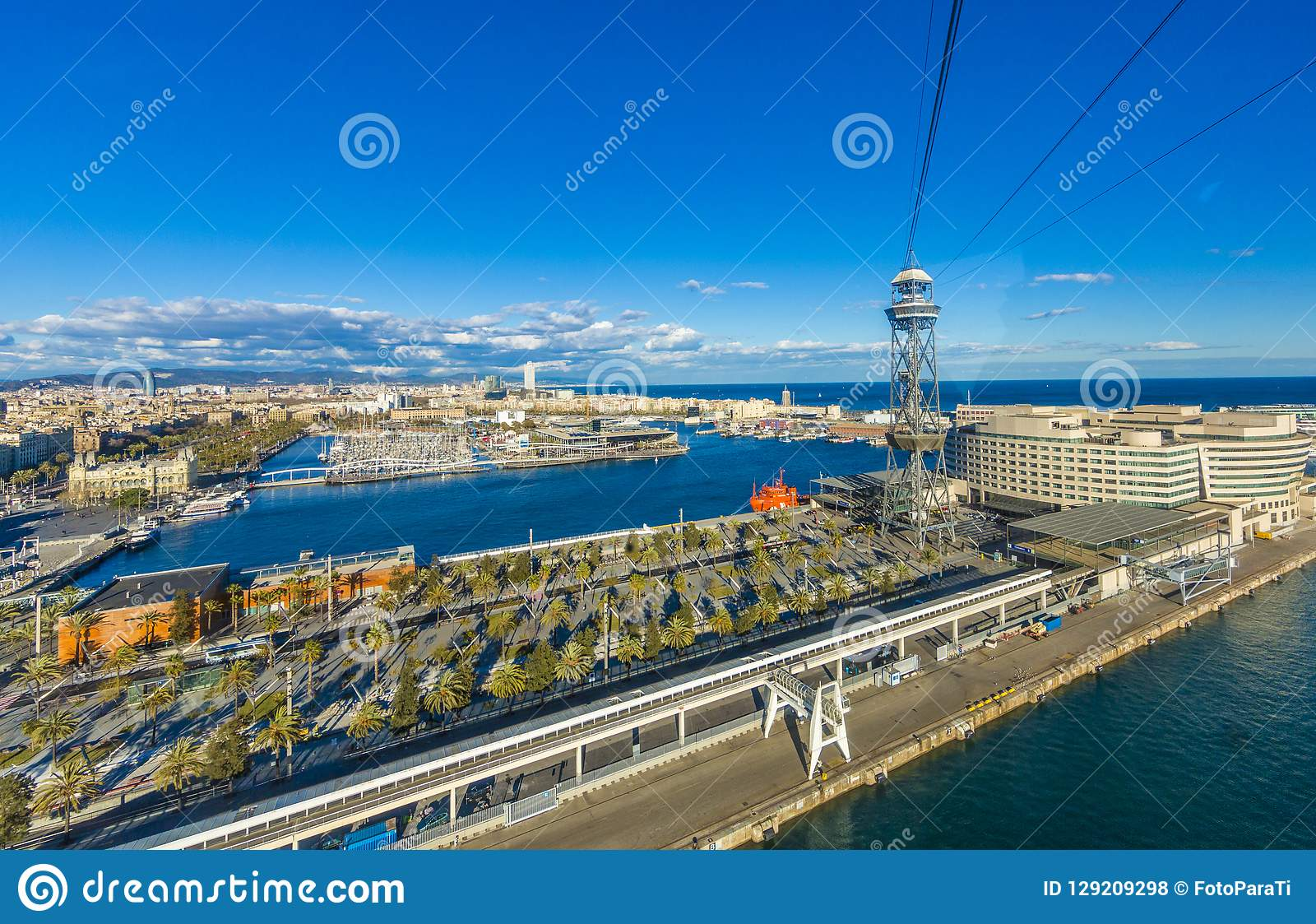 View of the port of Barcelona Spain from the cable car with its palm trees and the ocean