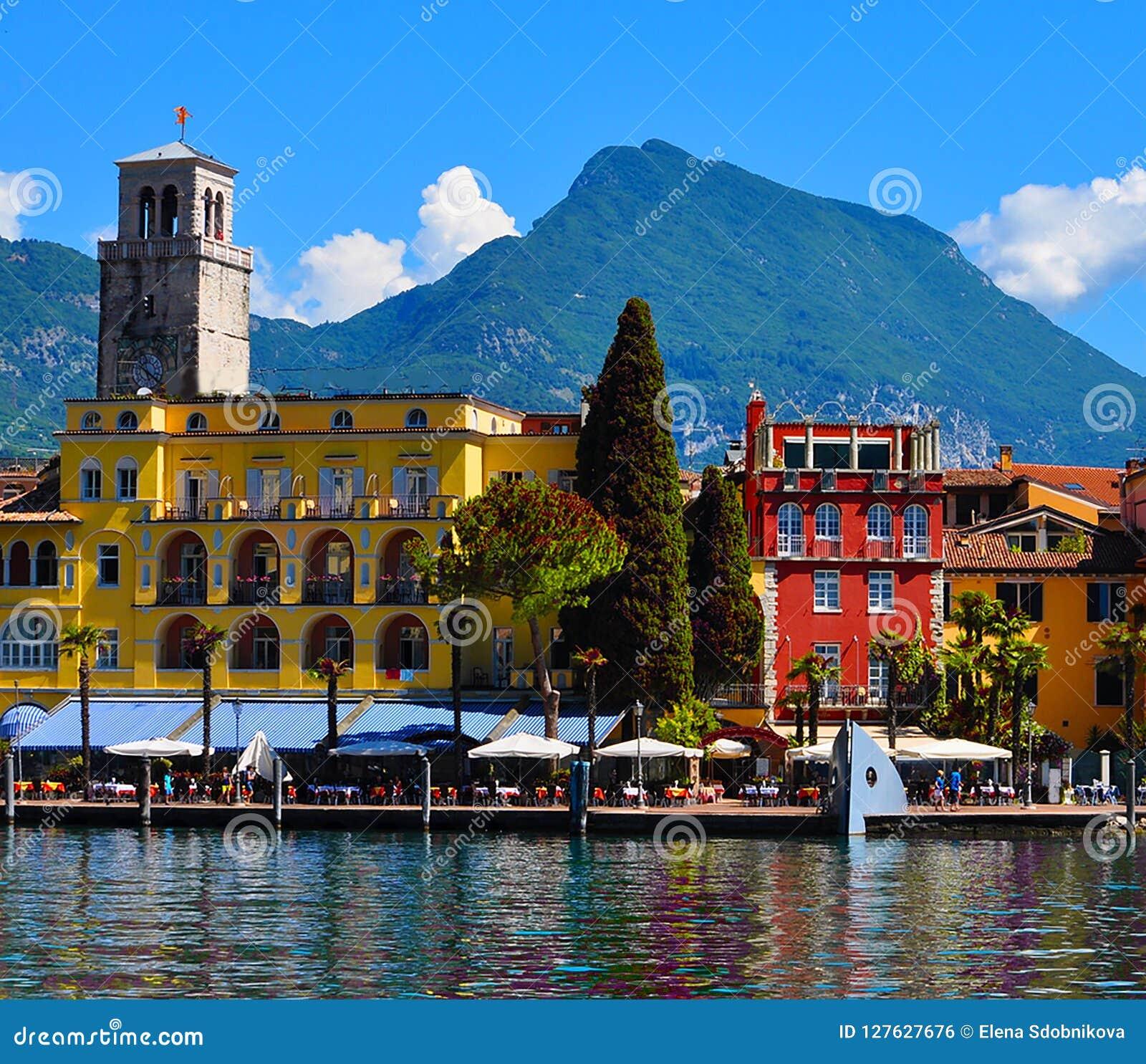 Beautiful view of Riva del Garda, of the embankment, cafes and restaurants. Lake Garda, region Lombardia, Italy