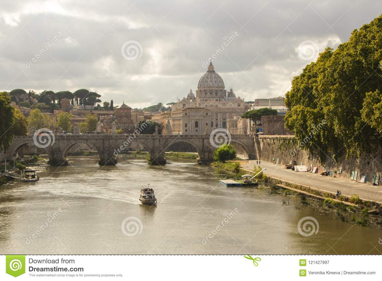 Rome, Italy - September 14, 2017: Beautiful view of St. Peter`s Basilica in the Vatican from the Tiber River in Rome.